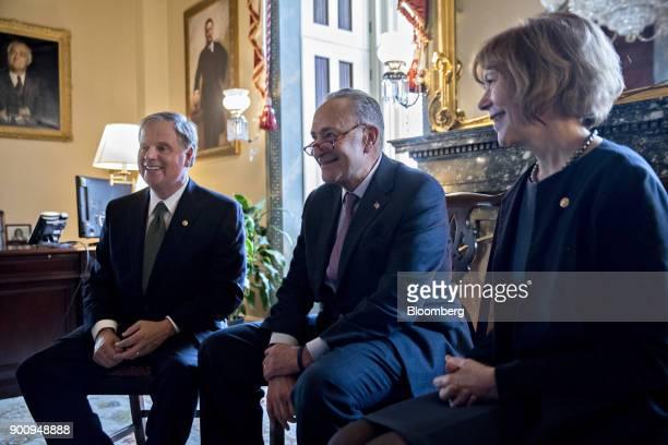 Senator Doug Jones a Democrat from Alabama from left Senate Minority Leader Chuck Schumer a Democrat from New York and Senator Tina Smith a Democrat...