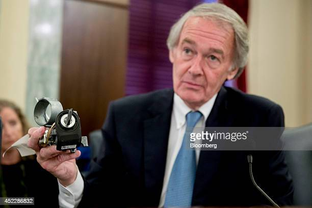 Senator Ed Markey a Democrat from Massachusetts holds up a General Motors Co ignition assembly during a Senate Consumer Protection Product Safety and...