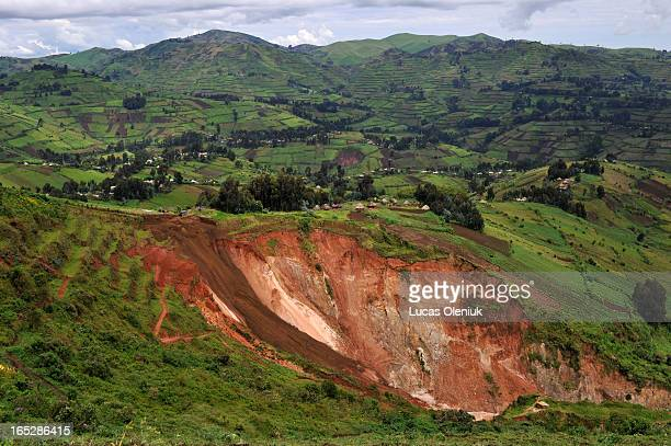 Senator Edouard Mwangachuchu's mining operation resembles a sink hole against the backdrop of Congolese farms in Masisi territory, North Kivu,...