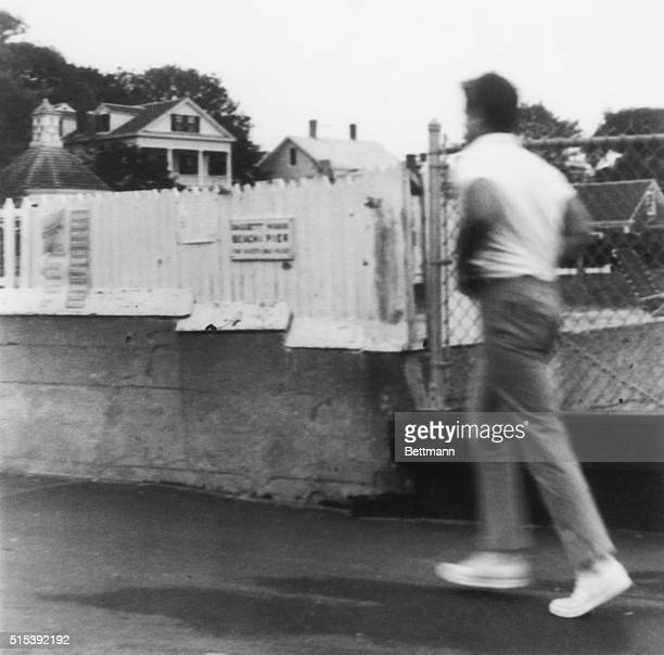Senator Edward Kennedy hurries as he leaves the Chappaquiddick Ferry as he leaves the Edgartown Center July 19th The Massachusetts Registry of Motor...