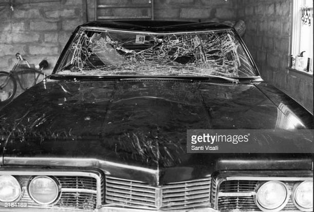 Senator Edward Kennedy's car with smashed windshield parked in a garage after his accident at Chappaquiddick Massachusetts 1969