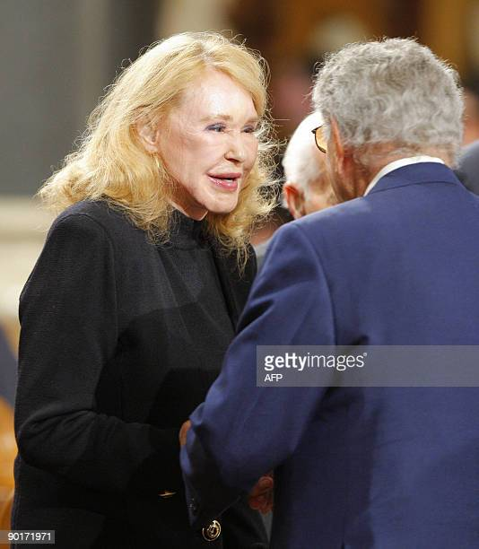 Senator Edward Kennedy's exwife Joan Kennedy talks to singer Tony Bennett before funeral services for US Senator Edward Kennedy at the Basilica of...
