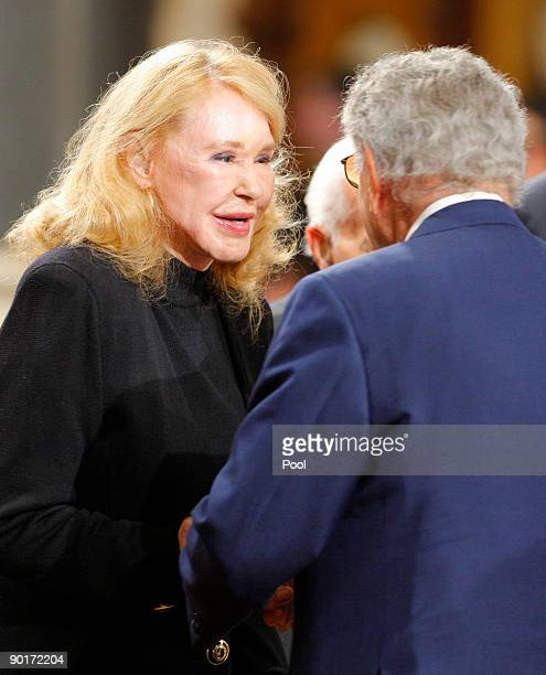 S Senator Edward Kennedy's exwife Joan Kennedy talks to singer Tony Bennett during funeral services for Sen Kennedy at the Basilica of Our Lady of...