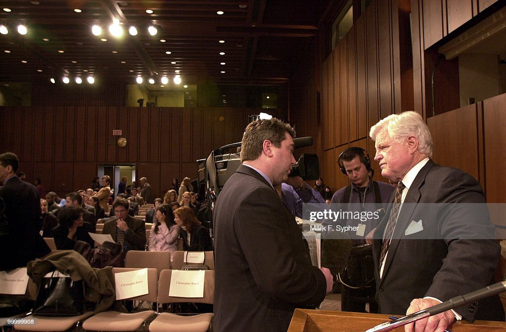 Senator Edward M. Kennedy (D-MA) gives a quick interview before the full committee hearing on Tuesday which examined the dangers of cloning and the promise of regenerative medicine, in the Hart Building.