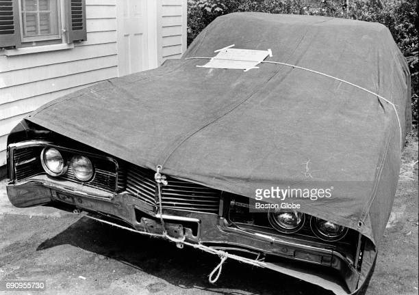 Senator Edward M Kennedy's wrecked car covered by a tarp Oct 23 1969 Late on July 18 Kennedy's car plunged into a pond on Chappaquiddick Island He...