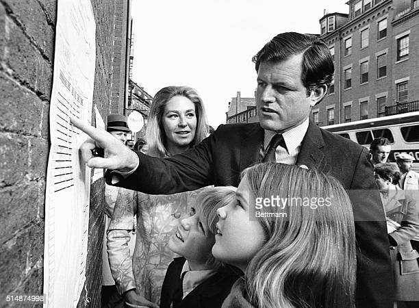 Senator Edward Ted Kennedy points out items on an election poster to his children Teddie and Kara at his family's polling place the Charles Street...