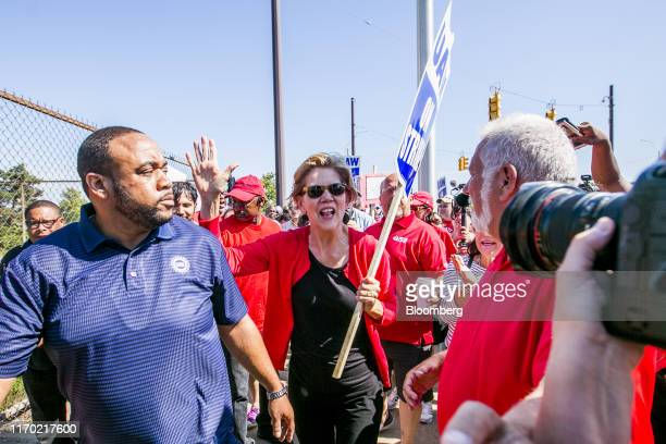 Senator Elizabeth Warren a Democrat from Massachusetts and 2020 presidential candidate center walks the picket line during a United Auto Workers...