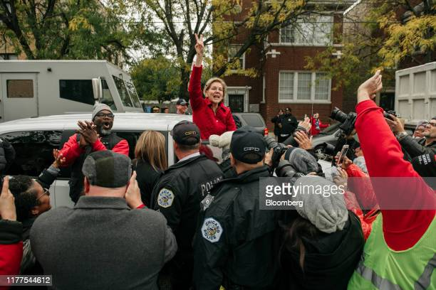 Senator Elizabeth Warren, a Democrat from Massachusetts and 2020 presidential candidate, gestures while leaving a teachers strike outside the Oscar...