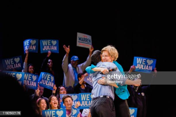 Senator Elizabeth Warren, a Democrat from Massachusetts and 2020 presidential candidate, right, hugs Julian Castro, former secretary of Housing and...