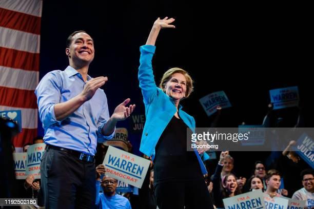 Senator Elizabeth Warren, a Democrat from Massachusetts and 2020 presidential candidate, right, waves as Julian Castro, former secretary of Housing...