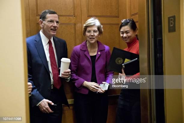 Senator Elizabeth Warren a Democrat from Massachusetts center and Senator John Barrasso a Republican from Wyoming stand on an elevator in the...