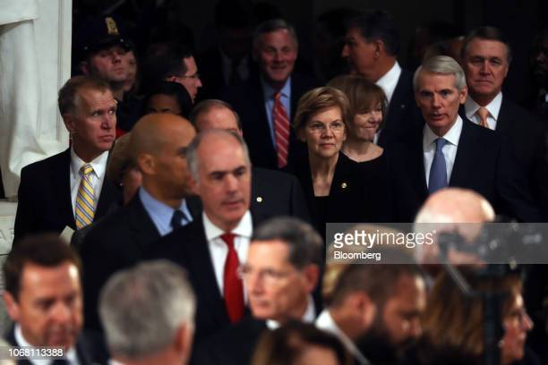 Senator Elizabeth Warren a Democrat from Massachusetts center arrives a memorial service for former US President George HW Bush at the Capitol...