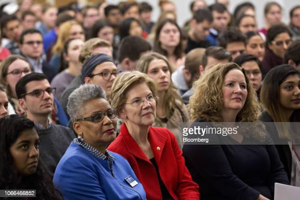 Senator Elizabeth Warren a Democrat from Massachusetts center waits to speak at American University in Washington DC US on Thursday Nov 29 2018...