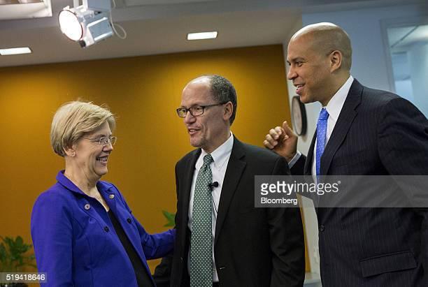 Senator Elizabeth Warren a Democrat from Massachusetts from left Thomas Perez US Secretary of Labor and Senator Cory Booker a Democrat from New...