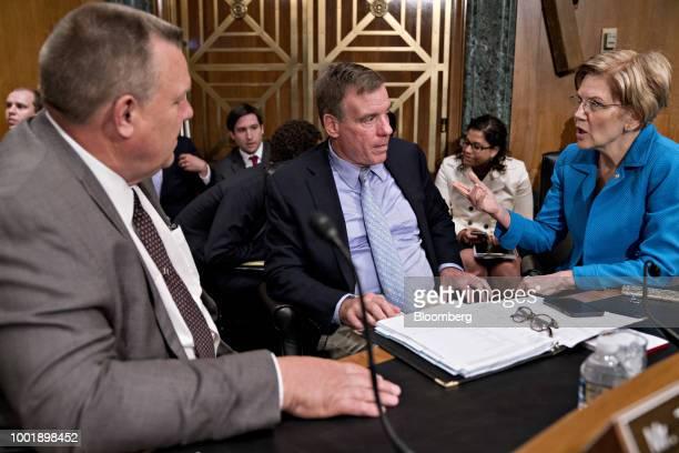 Senator Elizabeth Warren a Democrat from Massachusetts from right speaks with Senator Mark Warner a Democrat from Virginia and Senator Jon Tester a...