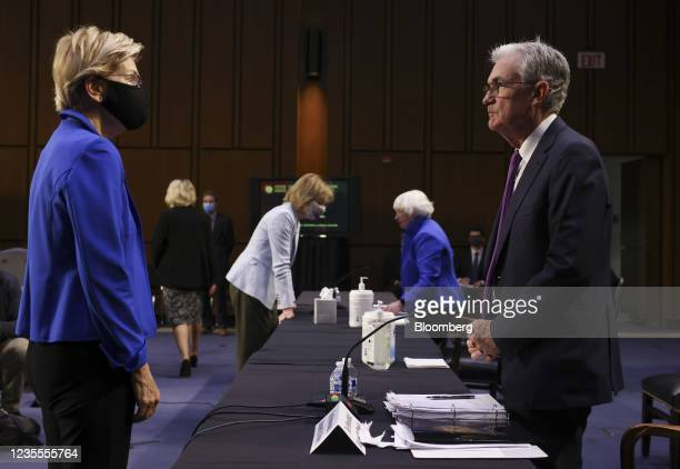Senator Elizabeth Warren, a Democrat from Massachusetts, left, speaks with Jerome Powell, chairman of the U.S. Federal Reserve, during a Senate...