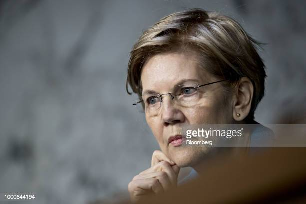 Senator Elizabeth Warren a Democrat from Massachusetts listens during a Senate Banking Committee hearing with Jerome Powell chairman of the US...