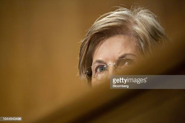 Senator Elizabeth Warren a Democrat from Massachusetts listens during a Senate Banking Committee hearing in Washington DC US on Tuesday Oct 2 2018...