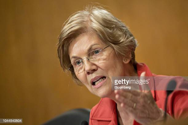 Senator Elizabeth Warren a Democrat from Massachusetts questions witnesses during a Senate Banking Committee hearing in Washington DC US on Tuesday...