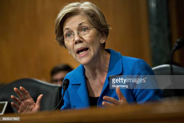 Senator Elizabeth Warren a Democrat from Massachusetts questions witnesses during a Senate Banking Committee nomination hearing with Kevin Hassett...