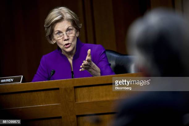 Senator Elizabeth Warren a Democrat from Massachusetts questions Jerome Powell chairman of the US Federal Reserve nominee for US President Donald...