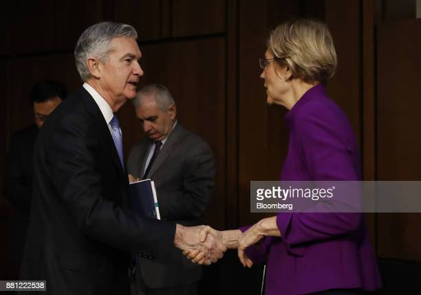 Senator Elizabeth Warren a Democrat from Massachusetts right shakes hands with Jerome Powell chairman of the US Federal Reserve nominee for US...