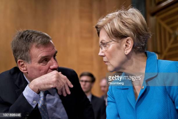 Senator Elizabeth Warren a Democrat from Massachusetts right talks to Senator Mark Warner a Democrat from Virginia before the start of a Senate...