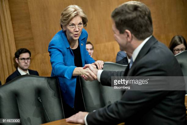 Senator Elizabeth Warren a Democrat from Massachusetts shakes hands with Jay Clayton chairman of the US Securities and Exchange Commission right...