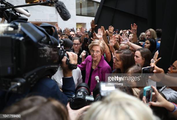 Senator Elizabeth Warren a Democrat from Massachusetts speaks to members of the media during a Senate Judiciary Committee hearing in Washington DC US...
