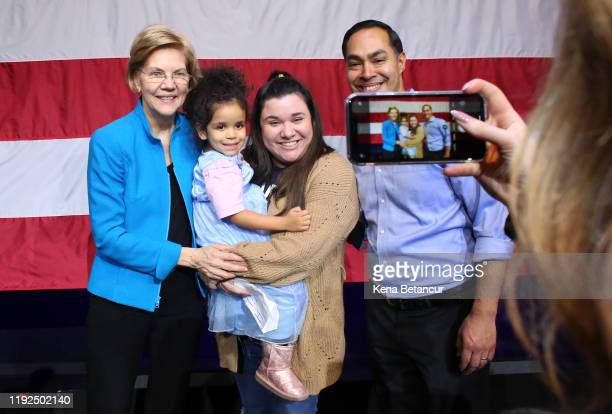 Senator Elizabeth Warren and Julian Castro pose for selfies with her followers during a rally on January 7 2020 in New York City After dropping out...