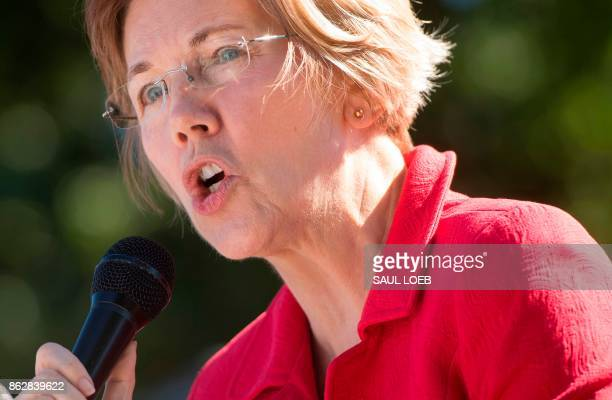 US Senator Elizabeth Warren Democrat from Massachusetts speaks to demonstrators as they hold a protest to demand more recovery assistance for areas...