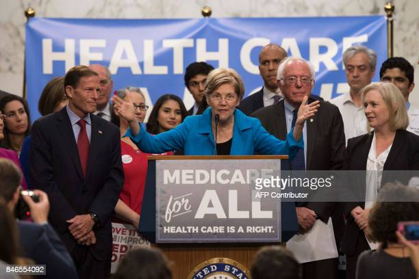 US Senator Elizabeth Warren Democrat from Massachusetts speaks with US Senator Bernie Sanders Independent from Vermont as they discusses Medicare for...