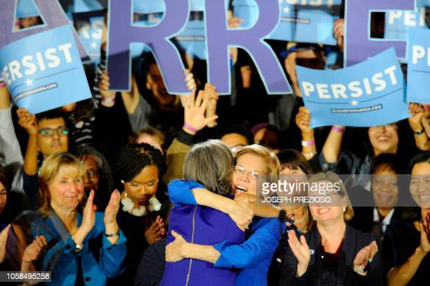 TOPSHOT Senator Elizabeth Warren embraces Congresswoman Katherine Clark before she addresses the audience during the Election Day Massachusetts...