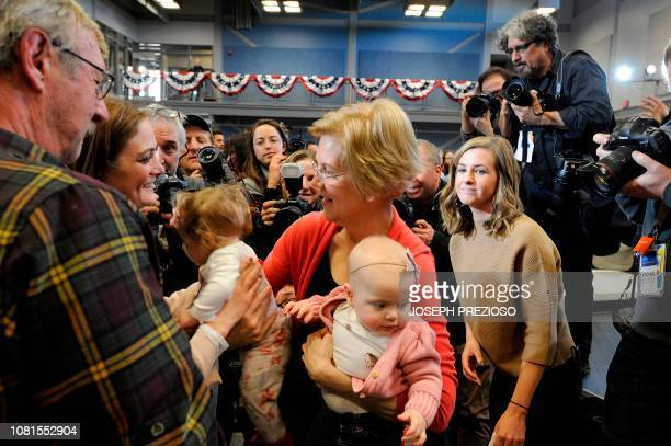 Senator Elizabeth Warren holds babies Adrienne Drugan and Grace Elliott after addressing an Organizing Event part of her exploratory presidential...