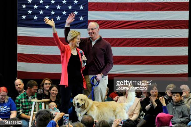 Senator Elizabeth Warren husband Bruce Mann and their dog Bailey take the stage before Warren addresses an Organizing Event as part of her...