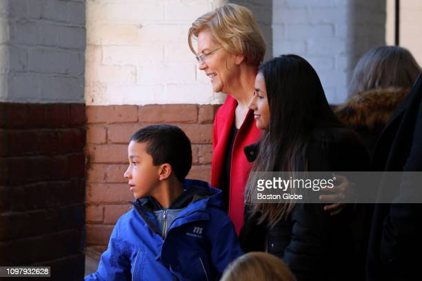 S Senator Elizabeth Warren looks over the crowd with her grandchildren Atticus and Lavinia Tyagi before officially announcing her run for the...