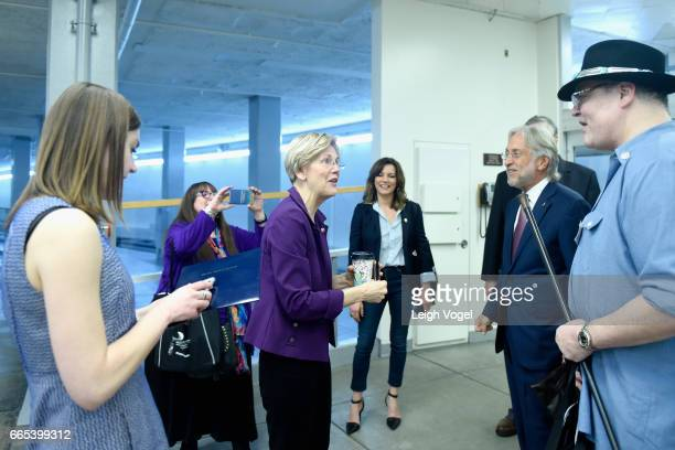 Senator Elizabeth Warren speaks with Martina McBride President of National Academy of Recording Arts and Sciences Neil Portnow and John Popper with...
