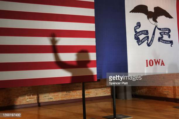 Senator Elizabeth Warren's shadow is reflected on a flag as she campaigns at the Maytag Events Complex on January 17, 2020 in Newton, Iowa. Warren,...