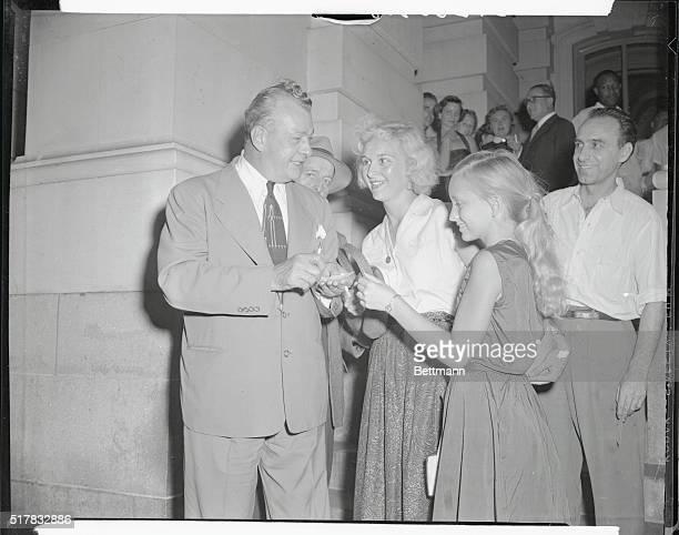 Senator Everett Dirksen, Illinois, is shown being rushed by autograph seekers outside the Senate Office Building. Dirksen, billed as Senator Joseph...