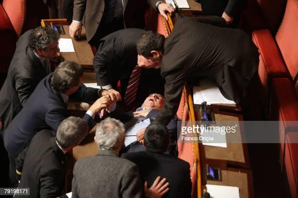 A senator faints during the confidence vote for Italian Prime Minister Romano Prodi 's government in the Italian Senate January 24 2008 in Rome Italy...