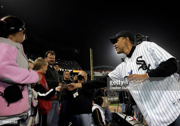S Senator for Illinois Barack Obama signs autographs prior to the start of Game Two of the American League Championship Series between the Chicago...