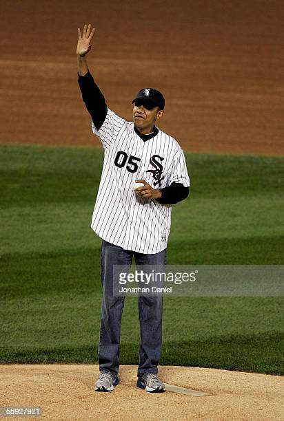 S Senator for Illinois Barack Obama wave from the mound before throwing out the ceremonial first pitch prior to the start of Game Two of the American...