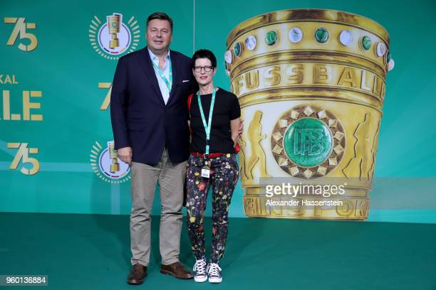 Senator for Interior of Berlin Andreas Geisel and his wife Anke pose for a photograph prior to the DFB Cup Final 2018 between Bayern Muenchen and...