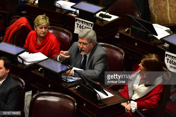 Senator for Neuquen Marcelo Jorge Fuentes delivers his speech next to Senator for Santa Cruz Cristina Fernandez de Kirchner at National Congress...