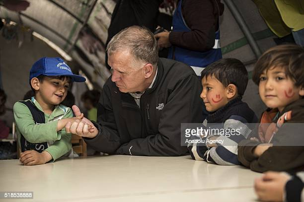 S Senator for North Caroline Thomas Tillis chats with the children during a visit a preschool at a tent city of Syrian refugees in Nizip district of...