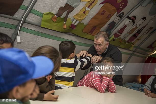 S Senator for North Caroline Thomas Tillis plays with kids during a visit a preschool at a tent city of Syrian refugees in Nizip district of Turkey's...