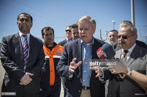 S Senator for South Carolina Lindsey Graham speaks to media after a visit to a tent city of Syrian refugees in Nizip district of Turkey's Gaziantep...