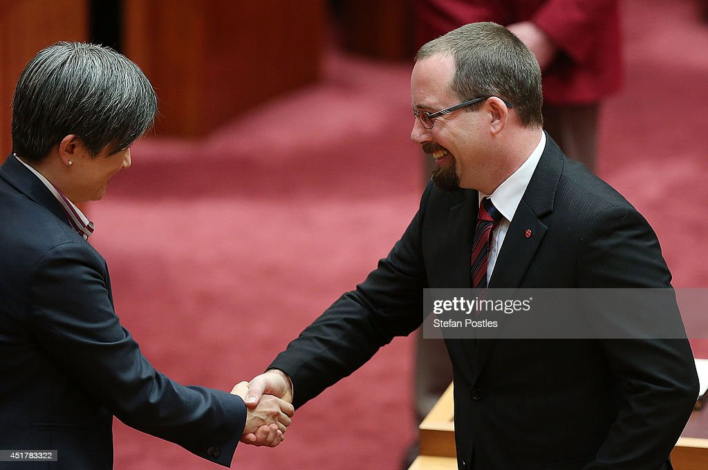 Senator for Victoria Ricky Muir (R) is congratulated by Senator Penny Wong during an official ceremony at Parliament on July 7, 2014 in Canberra, Australia. Twelve Senators will be sworn in today, with the repeal of the carbon tax expected to be first on the agenda.