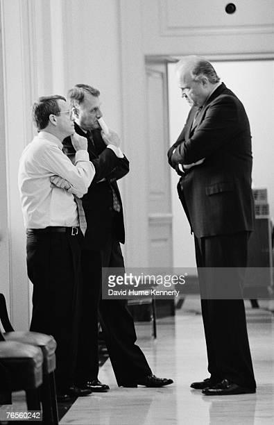 US Senator Fred Thompson US Senator Mike Dewine and US Senator Jon Kyl confer in a hallway of the Senate February 2 1999 in Washington DC