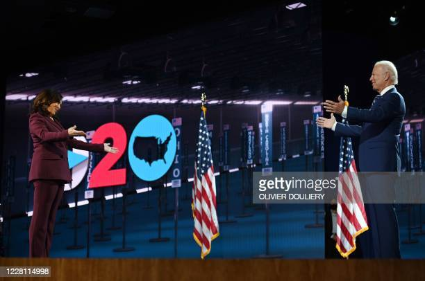 Senator from California and Democratic vice presidential nominee Kamala Harris stand on stage socially distanced from Former vice-president and...